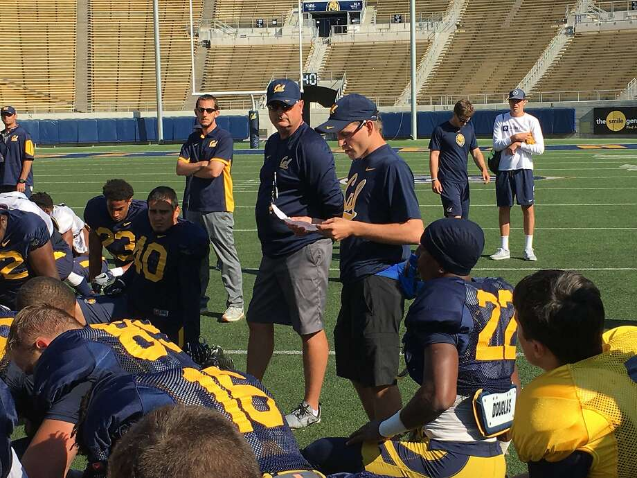 Cal equipment manager DanMatthiesen addresses the team after a recent practice at Memorial Stadium in Berkeley. Photo: Courtesy Of Kyle McRae, Cal Athletics