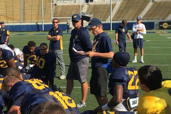 Cal equipment manager Dan�Matthiesen addresses the team after a recent practice at Memorial Stadium in Berkeley.