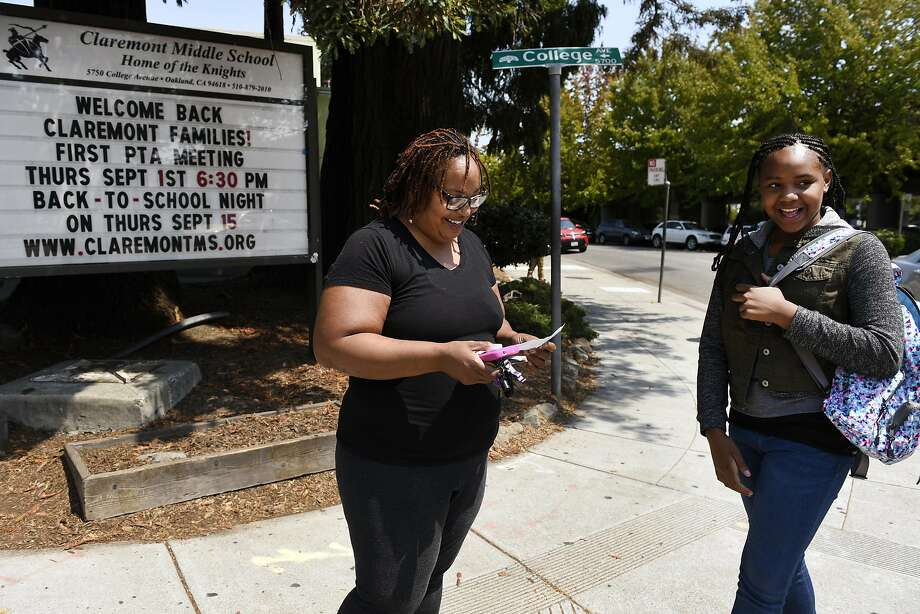 Robin Frazier talks with her daughter Nasrani Fanny while picking her up after her first day of sixth grade at Claremont Middle School in Oakland, CA Monday, August 22, 2016. Photo: Michael Short, Special To The Chronicle