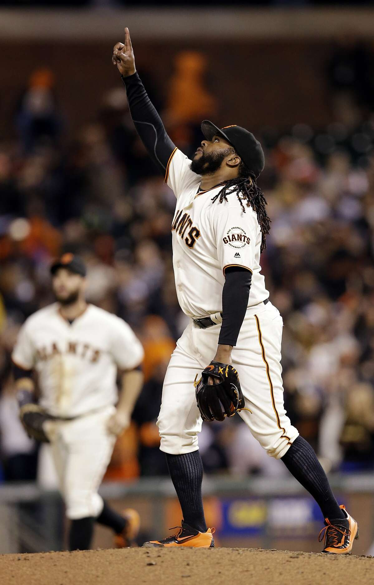 San Francisco Giants starting pitcher Johnny Cueto celebrates on the mound after pitching a seven-hit shutout against the San Diego Padres during a baseball game Tuesday, April 26, 2016, in San Francisco. San Francisco won 1-0. (AP Photo/Marcio Jose Sanchez)