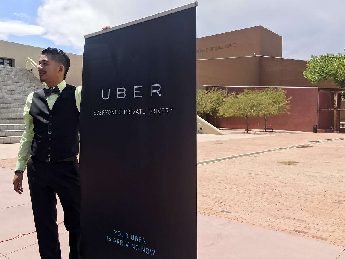 Isaac Sanchez, 28, a driver for ride-hailing company Uber, prepares to speak at a press conference Monday, Aug. 22, 2016, at the National Hispanic Cultural Center in Albuquerque, N.M., about Uber's extending the option to request Spanish-speaking drivers. The San Francisco-based Uber announced Monday the launch of uberESPANOL in New Mexico, the nation's most Hispanic state. (AP Photo/Russell Contreras)