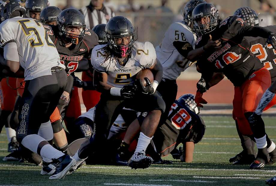 Antioch's Najee Harris (2) breaks away in a 44-42 win in a crosstown rivalry game against host Pittsburg in November. Harris, an Alabama commit, gained 9 pounds over the summer. Photo: Michael Macor, The Chronicle