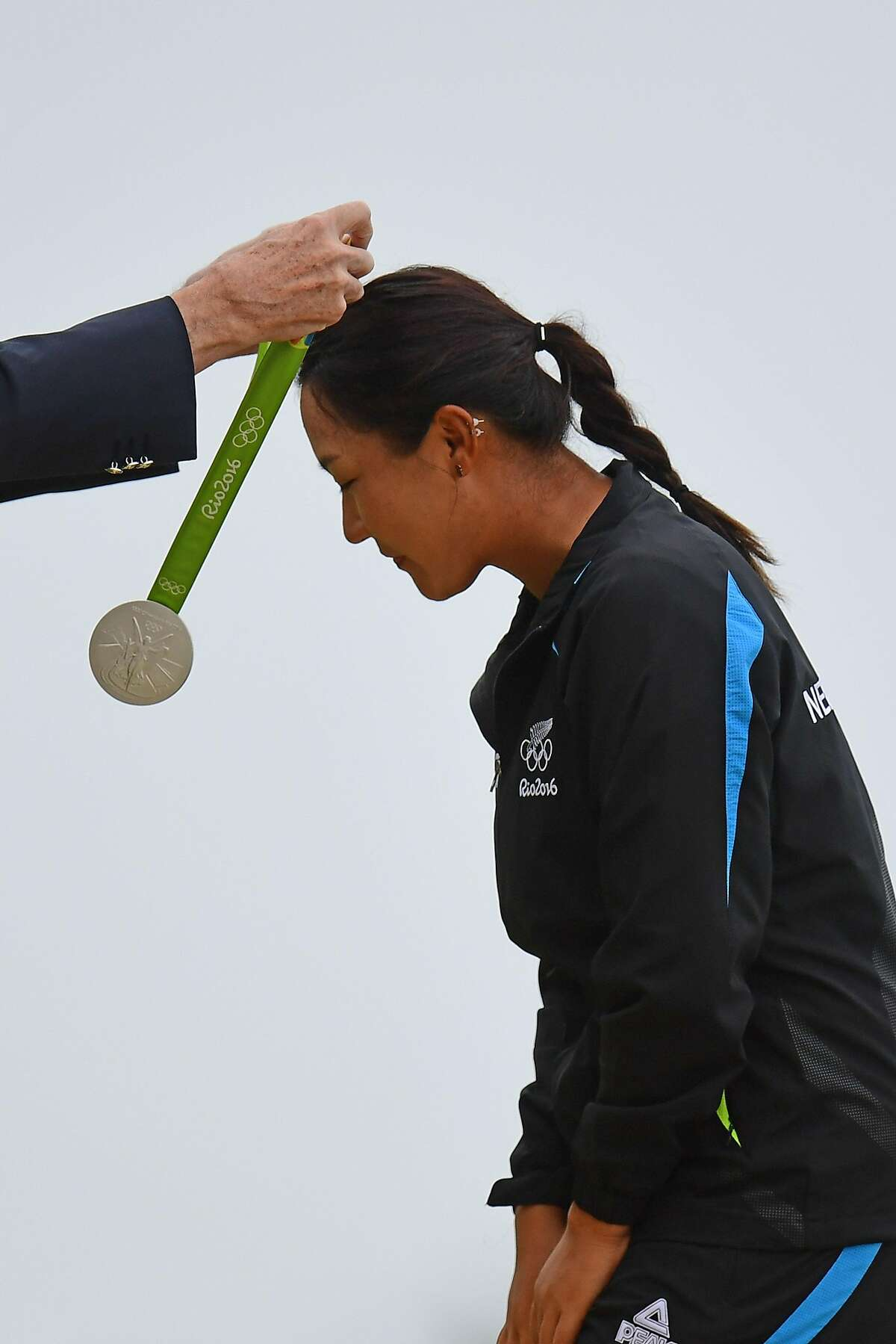 New Zealand's Lydia Ko receives her silver medal in the Women's individual stroke play at the Olympic Golf course during the Rio 2016 Olympic Games in Rio de Janeiro on August 20, 2016. / AFP PHOTO / Jim WATSONJIM WATSON/AFP/Getty Images