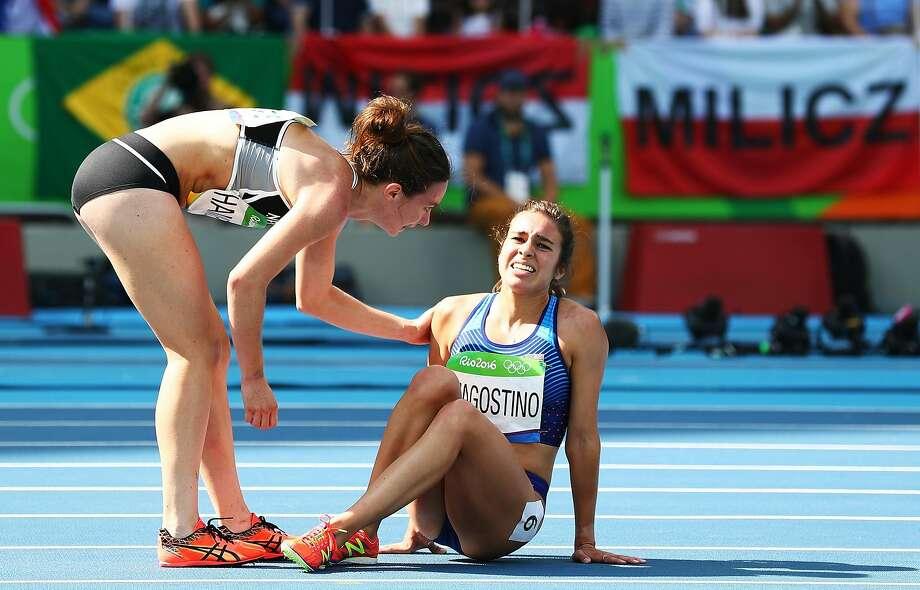 New Zealand's Nikki Hamblin helps America's Abbey D'Agostino in their 5,000-meter heat. Photo: Ian Walton, Getty Images