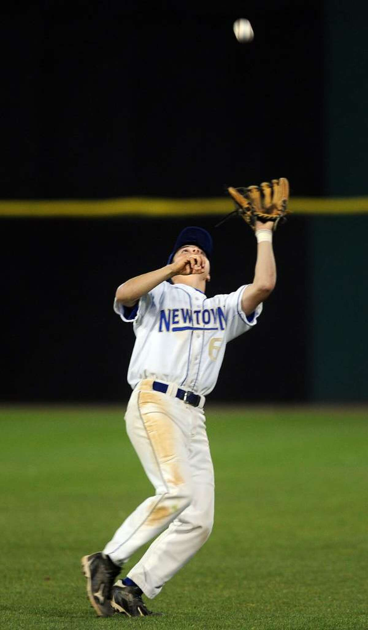 Newtown's Evan Noonan leans back to make a catch during Friday night's game against Weston at the Arena at Harbor Yard in Bridgeport.