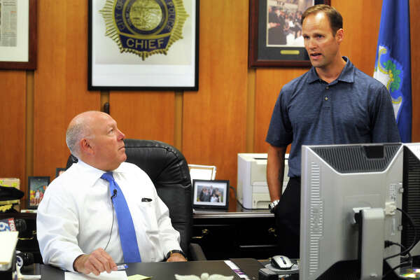 """Police Chief Armando """"A.J."""" Perez, left, holds  a press briefing in his office in Bridgeport, Conn. Aug. 22, 2016. Perez spoke about the continuing investigation into the shooting early Sunday morning where 13 people were hit by gunfire at a backyard house party. Perez is seen here with Capt. Brian Fitzgerald."""