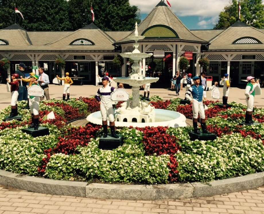 One of the attractions for fans on their way into the clubhouse entrance is the garden of jockey statues. People stop for pictures and ask strangers to snap shots of them as they mug next to the statues. In case you didn't know, the jockey statues represent the winners of last year's Grade I winners at the meet. Still 12 days left of the season if you want to get up here for a Kodak moment. (Tim Wilkin / Times Union)