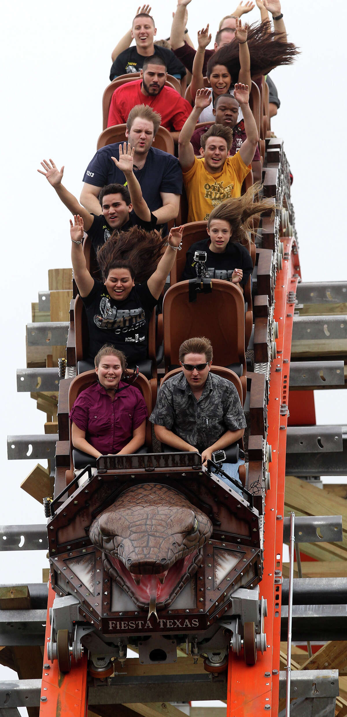 Iron Rattler People enjoy a drop on the new Iron Rattler roller coaster Wednesday May 15, 2013 during a media day event to introduce the ride at Six Flags Fiesta Texas.