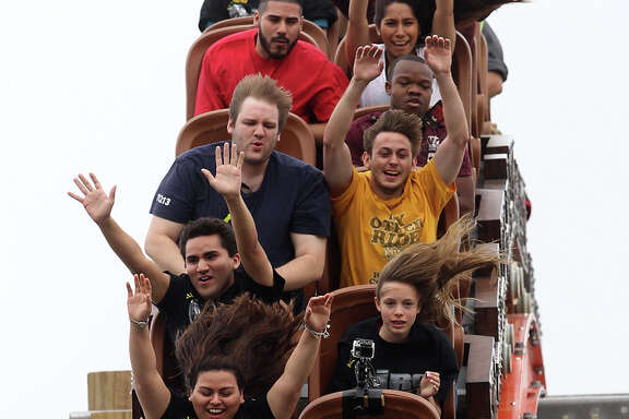 People enjoy a drop on the new Iron Rattler roller coaster Wednesday May 15, 2013 during a media day event to introduce the ride at Six Flags Fiesta Texas.