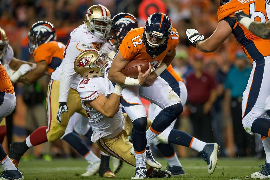 Quarterback Paxton Lynch #12 of the Denver Broncos is sacked by linebacker Marcus Rush #44 of the San Francisco 49ers a preseason NFL game at Sports Authority Field at Mile High on August 20, 2016 in Denver, Colorado. Photo: Dustin Bradford, Getty Images