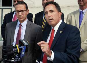 FBI Special Agent in Charge Andrew Vale, left, and U.S. Attorney Richard Hartunian speak with reporters after a U.S. District Court jury convicted Glendon Scott Crawford for charges that he built a machine that federal prosecutors contended he bragged could be used to kill Muslim's and others Friday, Aug. 21, 2015, in Albany, N.Y. (John Carl D'Annibale / Times Union)