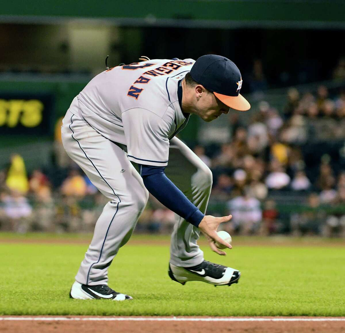 Houston Astros' Alex Bregman fields a ball off the bat of Pittsburgh Pirates' Jordy Mercer in the eighth inning of a baseball game against the Pittsburgh Pirates in Pittsburgh, Monday, Aug. 22, 2016. (AP Photo/Fred Vuich)