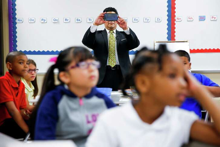 New Houston Independent School District Superintendent Richard Carranza takes a picture of a classroom at Law Elementary School as he visits schools around the district for the first day of school Monday, August 22, 2016 in Houston.