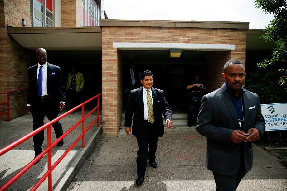 New Houston Independent School District Superintendent Richard Carranza, center, leaves Yates High School on his way to his next stop as he visits schools around the district for the first day of school Monday, August 22, 2016 in Houston. Photo: Michael Ciaglo, Houston Chronicle / © 2016  Houston Chronicle