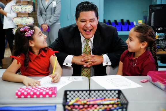 New Houston Independent School District Superintendent Richard Carranza, center, laughs with Law Elementary School students Natalie Galvin, 8, left, and Jasmin Vargas, 7, right, as he visits schools around the district for the first day of school Monday, August 22, 2016 in Houston.