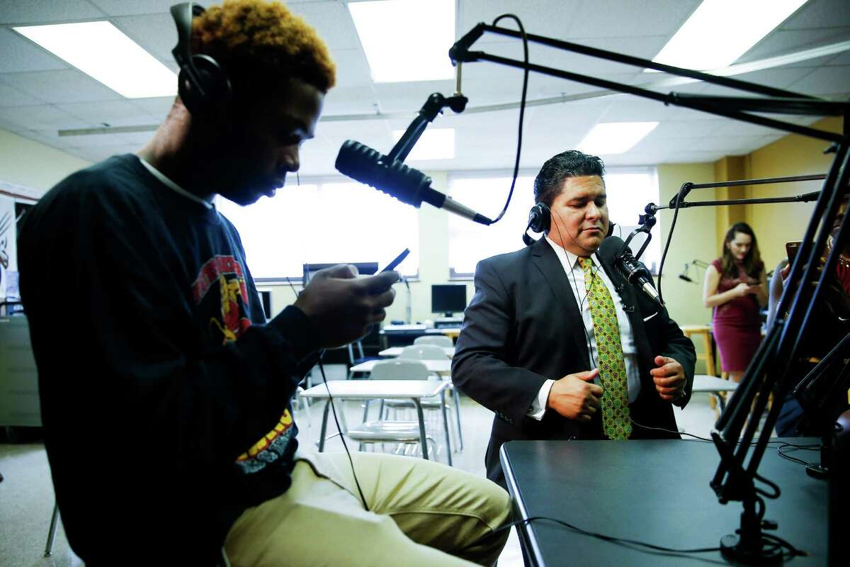 Superintendent Richard Carranza prepares to be interviewed Monday on the Yates High School radio station by sophomore Kenneth Lee.