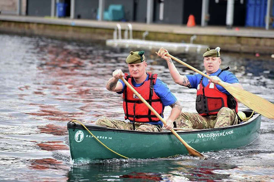 In this July 28, 2016 photo provided by the British Ministry of Defense, Pvt. Ryan O'Malley, foreground, and Color Sgt. Jim Gould of the Royal Regiment of Scotland paddle a canoe at the Pinkston Water Sports Complex in Glasgow, Scotland. Starting Aug. 30, 2016, they and 14 others plan to travel from Montreal to New York City by canoe, along lakes and rivers where their military forbearers fought and died during two 18th century wars. (Mark Owen/Ministry of Defense via AP) ORG XMIT: CAET297 Photo: Mark Owen / Ministry of Defense