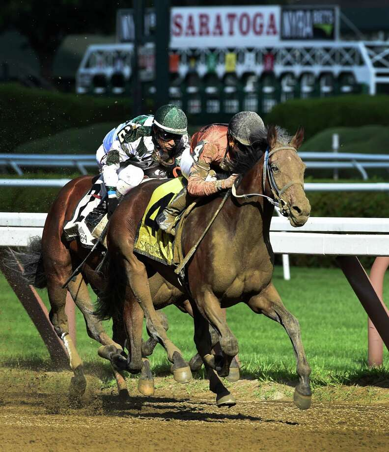 #4 Rachel's Temper with jockey Joel Rosario passes #2 Tiger Ride with jockey Edgar Prado to win the 3rd running of The Summer Coloney stake at the Saratoga Race Course Monday August 21, 2016 in Saratoga Springs, N.Y.    (Skip Dickstein/Times Union) Photo: SKIP DICKSTEIN