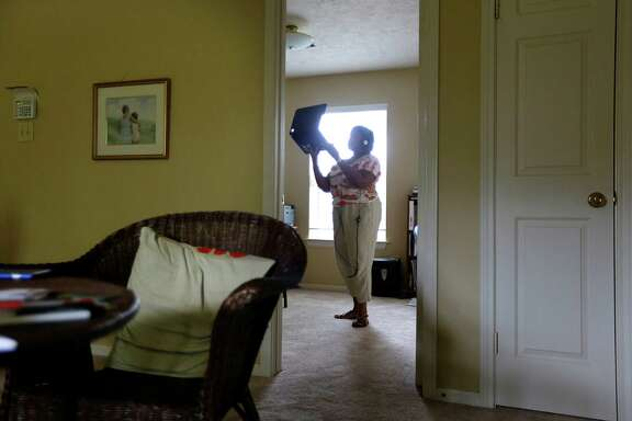 Shelia Muldrow holds up her computer to show her son, Warren, around her house during a video chat last week. Her son is in the Fort Bend County Jail, currently awaiting an order to send him to a hospital.