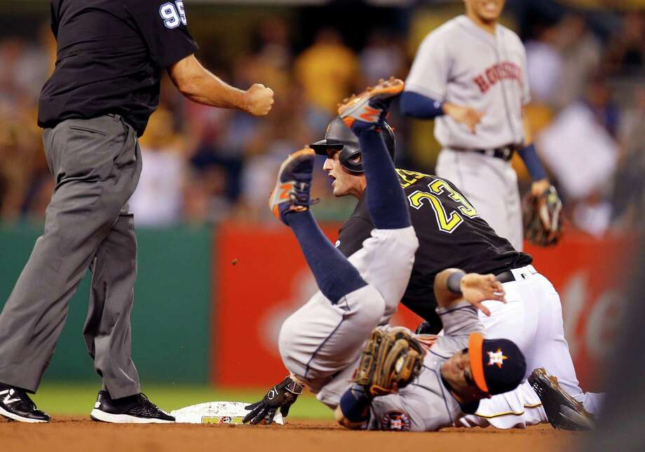 The Astros' 3-1 victory ends on an ill-advised bit of baserunning by the Pirates' David Freese (23), who was tagged out by Jose Altuve when he tried to advance to second after reaching on a throwing error. Photo: Justin K. Aller, Stringer / 2016 Getty Images