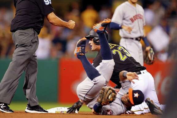 The Astros' 3-1 victory ends on an ill-advised bit of baserunning by the Pirates' David Freese (23), who was tagged out by Jose Altuve when he tried to advance to second after reaching on a throwing error.