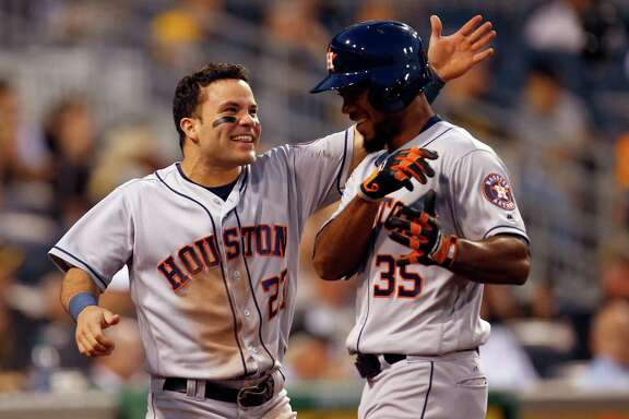 Jose Altuve greets Teoscar Hernandez after the Astros rookie's two-run homer in the fifth inning, his third in only 32 major league at-bats.