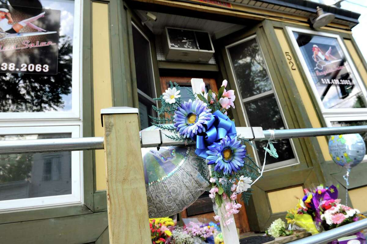 A memorial for salon worker Jacquelyn Porreca, 32, who was stabbed and killed on Friday, is in place at Recycled Salon on Tuesday, Aug. 25, 2015, Colonie, N.Y. (Cindy Schultz / Times Union archive)