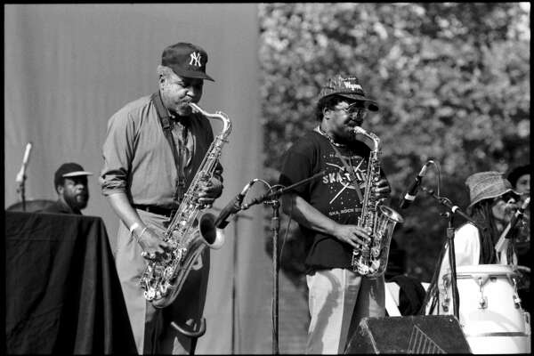 UNITED STATES - JANUARY 01:  CENTRAL PARK  Photo of SKATALITES, The Skatalites - Roland Alphonso (l) & 'Deadly' Headley Bennett (r) at Central Park, NYC 1998  (Photo by David Corio/Redferns)