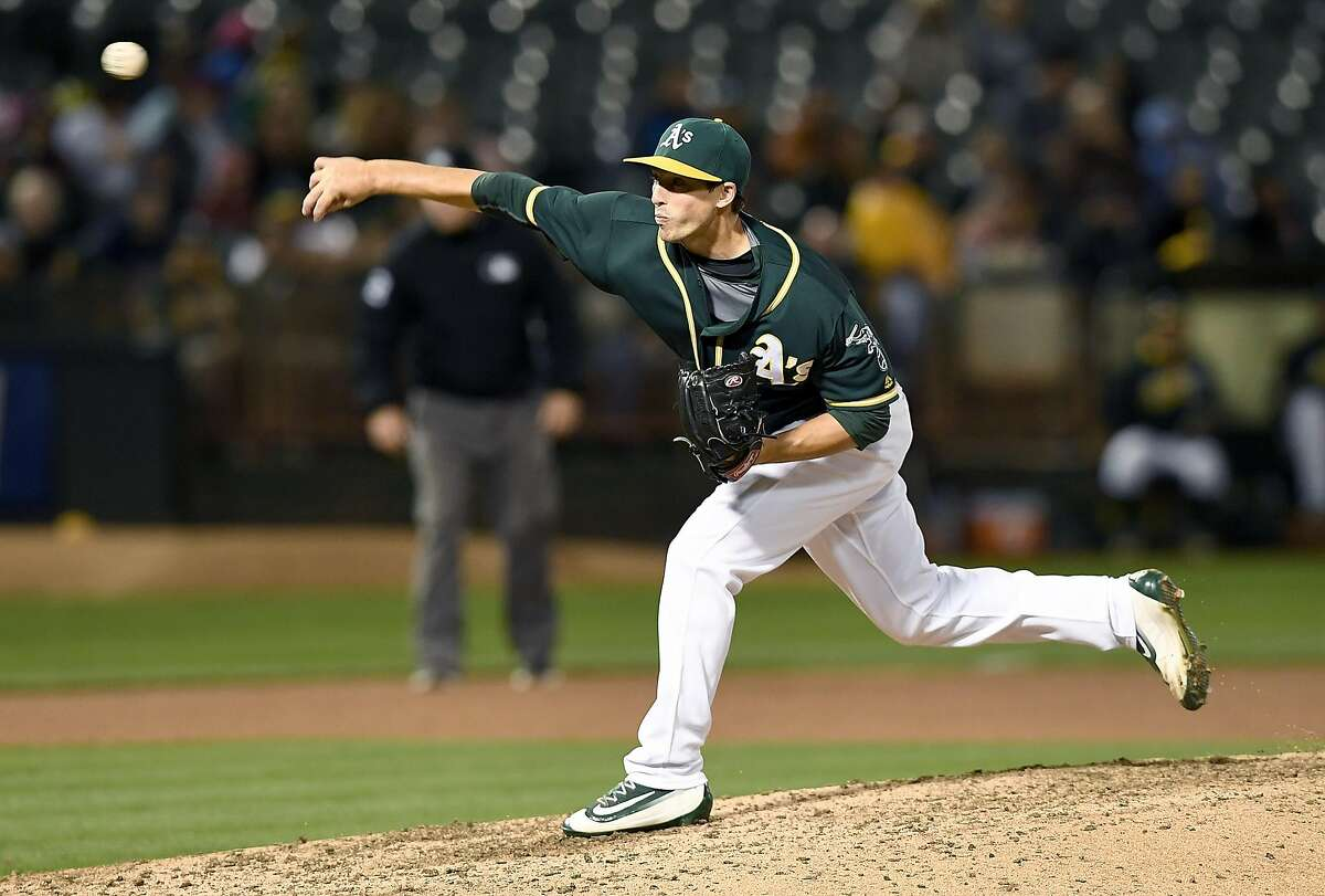 OAKLAND, CA - AUGUST 22: Ryan Dull #66 of the Oakland Athletics pitches against the Cleveland Indians in the top of the eighth inning at O.co Coliseum on August 22, 2016 in Oakland, California. (Photo by Thearon W. Henderson/Getty Images)