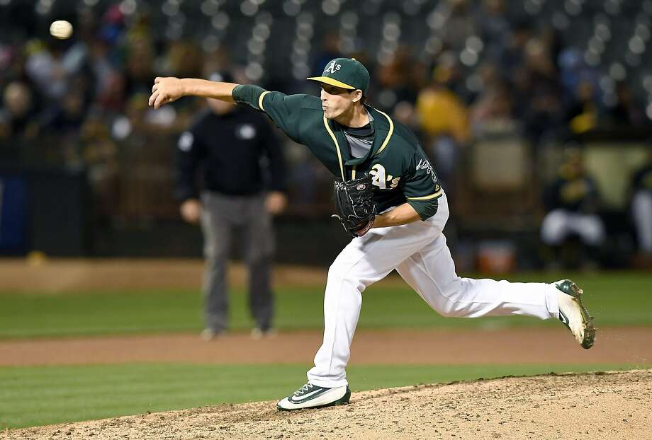 OAKLAND, CA - AUGUST 22:  Ryan Dull #66 of the Oakland Athletics pitches against the Cleveland Indians in the top of the eighth inning at O.co Coliseum on August 22, 2016 in Oakland, California.  (Photo by Thearon W. Henderson/Getty Images) Photo: Thearon W. Henderson, Getty Images