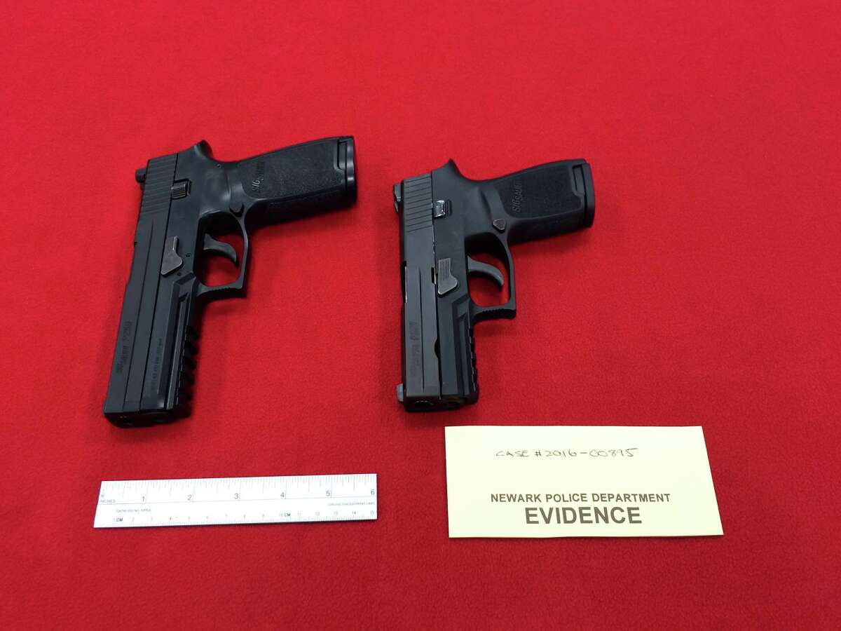 A photo of the pellet gun used in the robbery (left) next to a regular handgun.