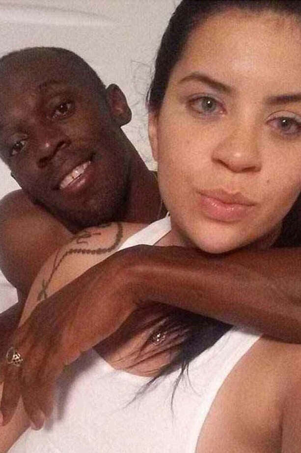 Photos of Usain Bolt and a woman who is not his Jamaican girlfriend were recently leaked via the app, Whatsapp. Photo: Whatsapp