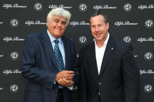 CARMEL, CA - AUGUST 19:  Jay Leno and Alfa Romeo CEO Reid Bigland pose for a photo at Folktale Winery on August 19, 2016 in Carmel, California.  (Photo by Kelly Sullivan/Getty Images for The Hollywood Reporter)