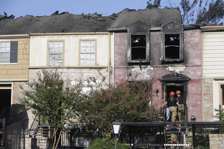 A firefighter is shown inside a burned apartment at the scene of a fire at Briarwood Apartments on Winrock near Westheimer, Tuesday, August 23, 2016 in Houston. Photo: Melissa Phillip/Houston Chronicle