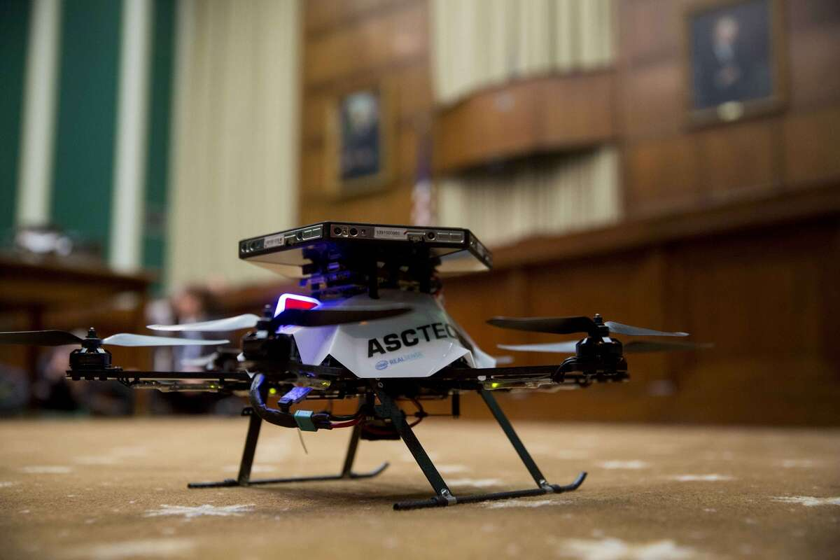 An AscTec Firefly unmanned aerial vehicle (UAV), or drone, sits on the floor during a House Energy and Commerce subcommittee hearing on Nov. 19, 2015, in Washington, D.C. (Bloomberg photo by Andrew Harrer)