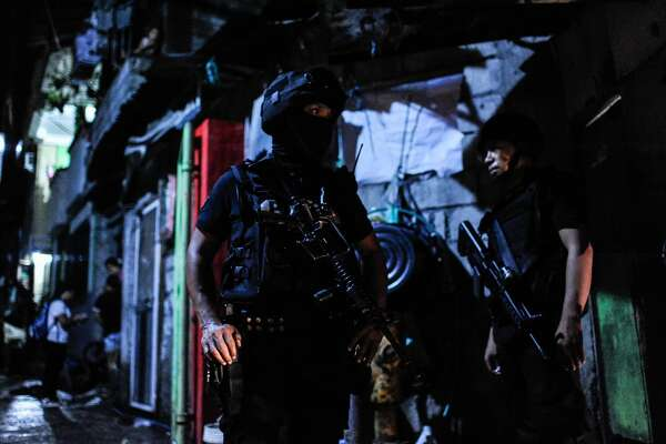 MANILA, PHILIPPINES - AUGUST 20:  Police swat teams guard the entrance to a shanty community during an earlier drug raid which killed an alleged drug suspect on August 20, 2016 in Manila, Philippines. The death toll from the Philippines' war on drugs initiated by President Rodrigo Duterte has spiked to nearly 1,800 since he took office in June, a figure much higher than the 900 deaths previously cited by officials. International human rights advocates have condemned the killings as out of control and  are calling on the government to end the nightly drug raids and investigate extrajudicial killings, although the president has lashed out at critics and threatened to withdraw from the United Nations. According to reports, investigations are still ongoing for 1,067 drug-related killings, reportedly carried out by vigilantes but it was unclear how many were directly related to the illegal drug trade. (Photo by Dondi Tawatao/Getty Images)