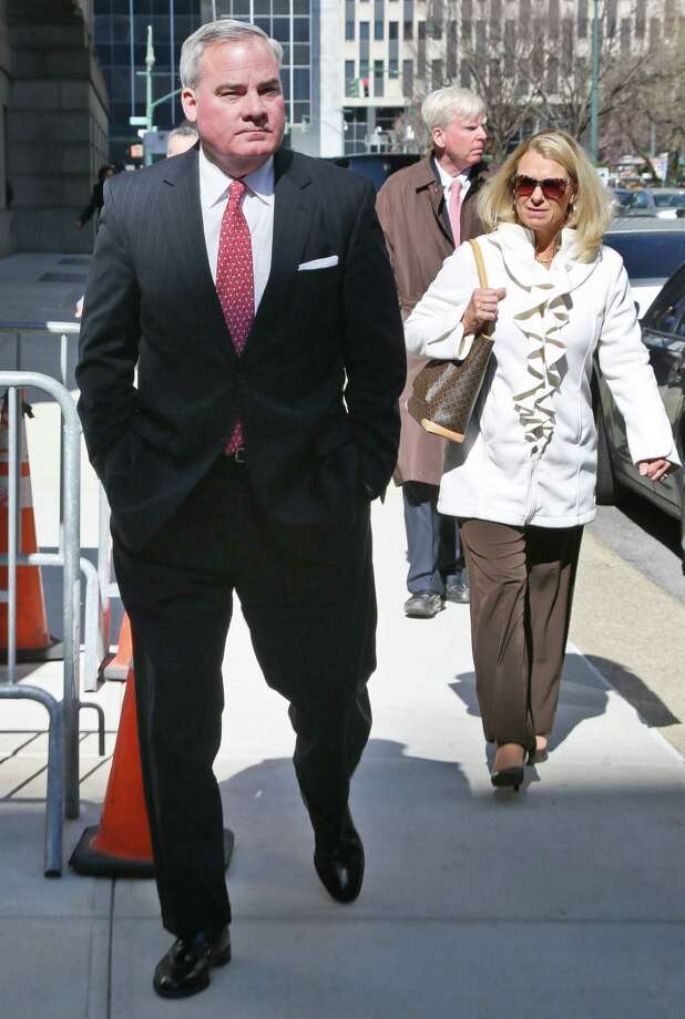Former Connecticut Gov. John Rowland, left, leaves with his wife Patricia, right, at federal appeals court on Friday, March 18, 2016 in New York. Rowland has asked a federal appeals court to overturn his political corruption conviction.  (AP Photo/Bebeto Matthews) Photo: Bebeto Matthews / AP / Copyright 2016 The Associated Press. All rights reserved. This material may not be published, broadcast, rewritten or redistribu