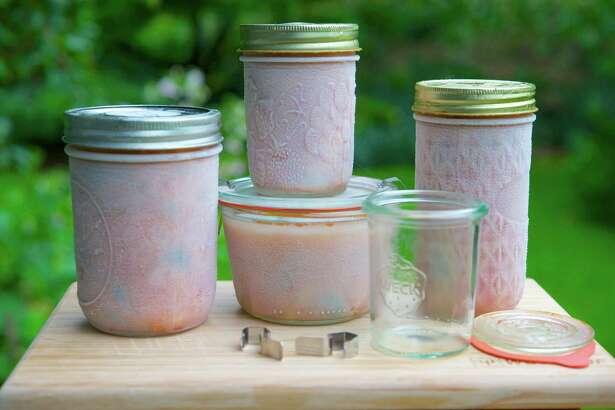 Jars of frozen tomato sauce