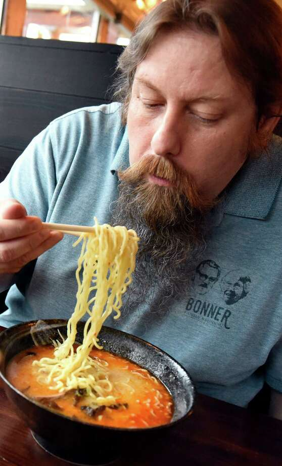 Sim Morrell enjoys a ramen dish with his wife, Eleonora Morrell, on Thursday, July 28, 2016, at Tanpopo Ramen and Sake Bar in Albany, N.Y. (Cindy Schultz / Times Union) Photo: Cindy Schultz / Albany Times Union