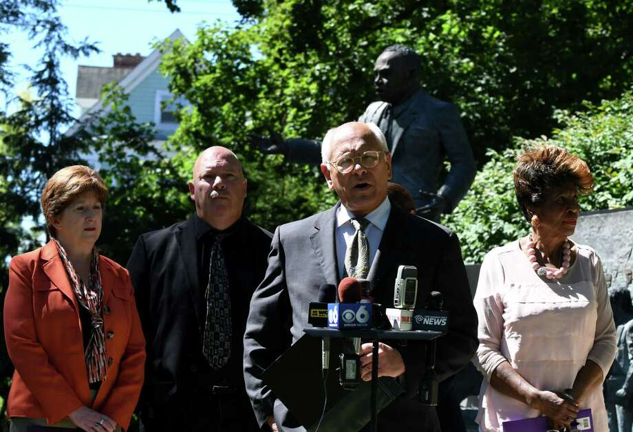 U.S. Rep. Paul Tonko speaks during a press conference where local leaders called on Congress to protect access to the ballot box for those affected by 2013 Supreme Court decision to gut Section 4 of the Voting Rights Act on Tuesday, Aug. 23, 2016, in Albany, N.Y. Mayor left, Kathy Sheehan, left, Mark Emanatian, senior field coordinator Capital District Area Labor Federation and Anne Pope, director, Northeastern New York Region of the NAACP, right, also spoke. (Will Waldron/Times Union) Photo: Will Waldron / 20037746A