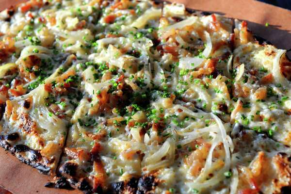 Flammkuchen flatbread with bacon lardons and thin sliced onions at The Flammerie on Wednesday Feb. 25, 2015 in Kinderhook, N.Y. (Michael P. Farrell/Times Union) ORG XMIT: MER2015022521512534