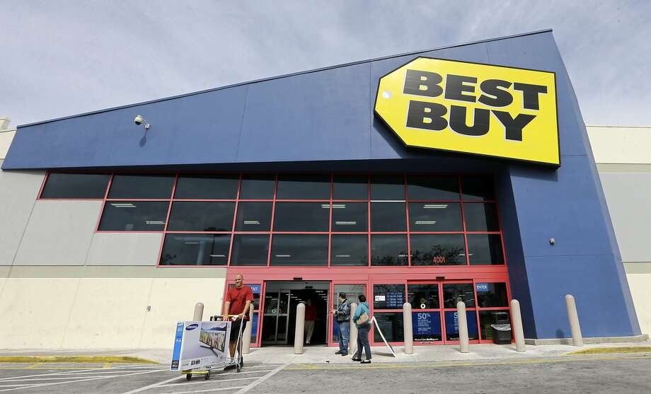 FILE - In this Tuesday, Feb. 9, 2016, file photo, a shopper carts his purchased LED TV at a Best Buy in Miami. On Tuesday, Aug. 23, Best Buy reports financial results. (AP Photo/Alan Diaz, File) Photo: Alan Diaz, Associated Press