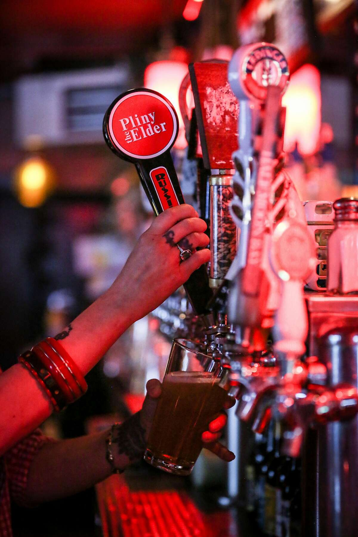 Bartender Christina Lingys pours a pint of the highly sought after Pliny the Elder by Russian River Brewing Co at The Page in San Francisco on Thursday, Aug. 18th.
