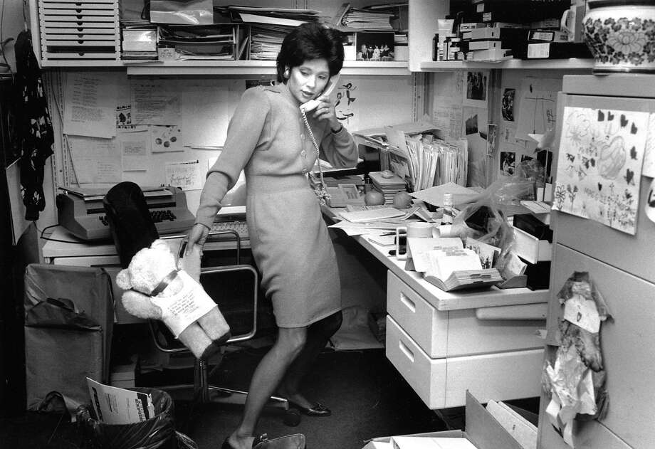 WENDY TOKUDA (July 31, 1990) The anchor works during a busy day at KPIX. According to the photo caption, she's returning calls, and the bear is from a young fan. Note the children's artwork on her filing cabinet. Photo: Liz Hafalia, The Chronicle
