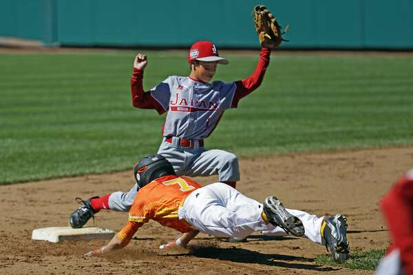 San Antonio, Tex.'s Britton Moore (7) is caught off second base by Japan second baseman Shotoku Satoa completing an inning ending double play during the first inning of a consolation baseball game at the Little League World Series tournament in South Williamsport, Pa., Tuesday, Aug. 23, 2016. (AP Photo/Gene J. Puskar)