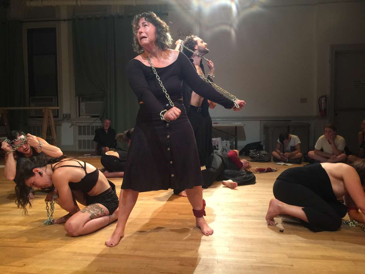"""The Living Theatre performs """"Seven Meditations on Political Sadomasochism"""" earlier this month at the University Settlement in New York City."""