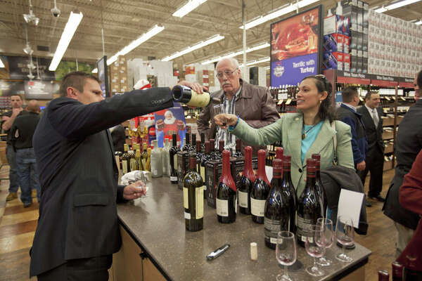 At the Total Wine & More grand opening in Norwalk, customers sample some wine at the store's tasting station.