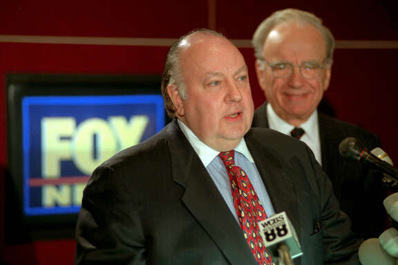 Roger Ailes (left) speaks at a 1996 news conference as Rupert Murdoch looks on. Former Fox News host Andrea Tantaros has charged in a lawsuit that she was sexually harassed by Ailes and other top executives.