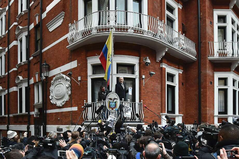 (FILES) This file photo taken on February 05, 2016 shows WikiLeaks founder Julian Assange addressing the media holding a printed report of the judgement of the UN's Working Group on Arbitrary Detention on his case from the balcony of the Ecuadorian embassy in central London on February 5, 2016. The Ecuadorian government on August 23, 2016 criticised British authorities after security intercepted an intruder trying to enter its London embassy, where WikiLeaks founder Julian Assange has been sheltering since 2012. / AFP PHOTO / BEN STANSALLBEN STANSALL/AFP/Getty Images Photo: BEN STANSALL, AFP/Getty Images