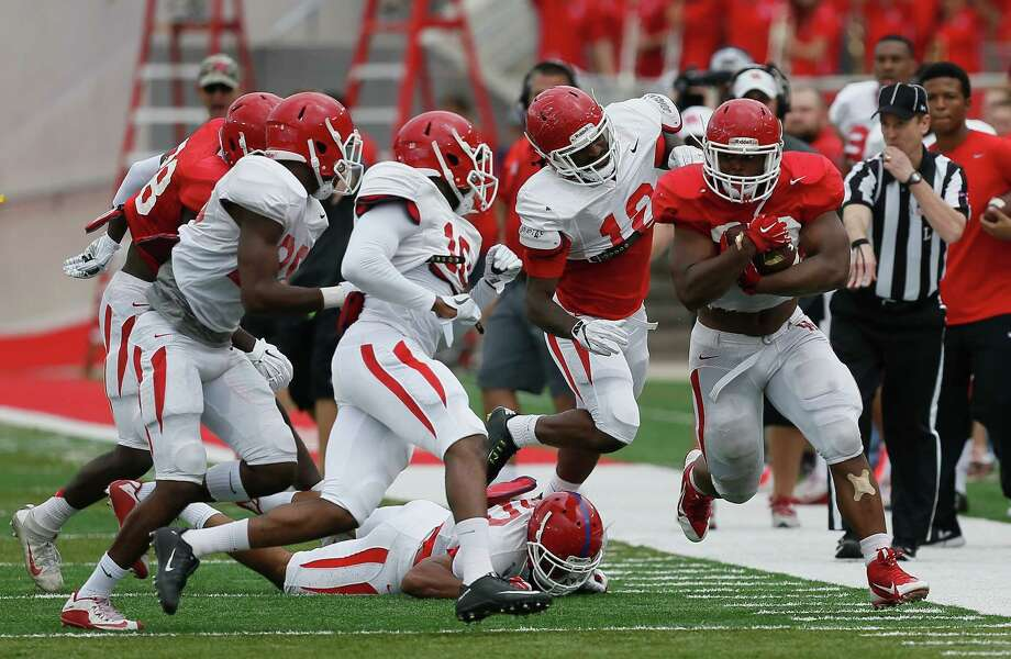 Houston Cougars running back Josh Burrell (28) rushes with the ball during the Houston Cougars Red and White game, Saturday, April 16, 2016, in Houston. (Bob Levey/ For The Houston Chronicle) Photo: Bob Levey, For The Chronicle / ©2016 Bob Levey